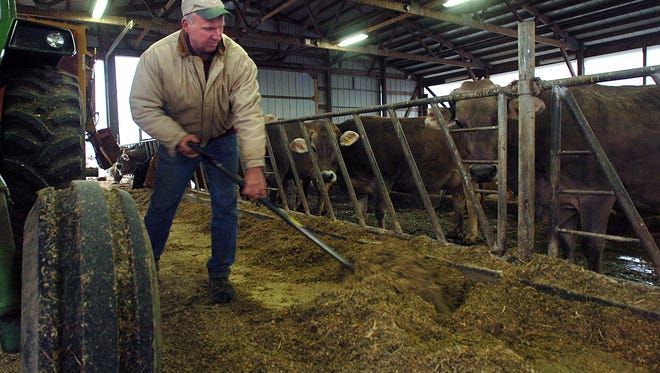 Tom Oberhaus works in his barn at Cozy Nook Farm on Highway 18 in the town of Delafield.
