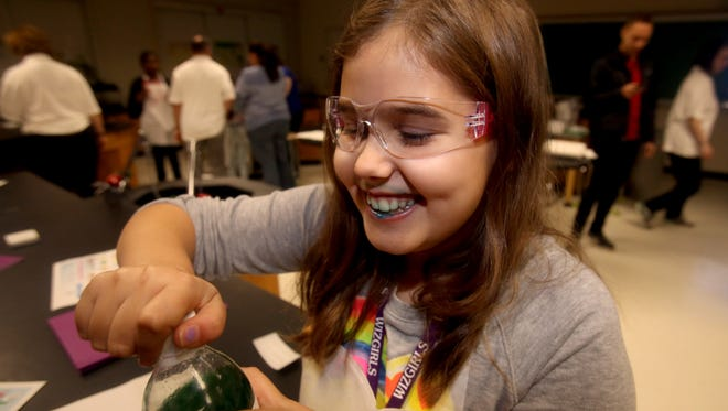Molly Martin, 10, of Irvington, is left with a face full of color after taking a sip of soda that she created in a soda making workshop during the 2nd annual WizGirls-Building the Future event at Ardsley Middle School Oct. 29, 2106. Over 200 girls in 4th through 7th grades from Westchester County and New York City took part in the event which included over a dozen science, technology, and engineering related workshops.