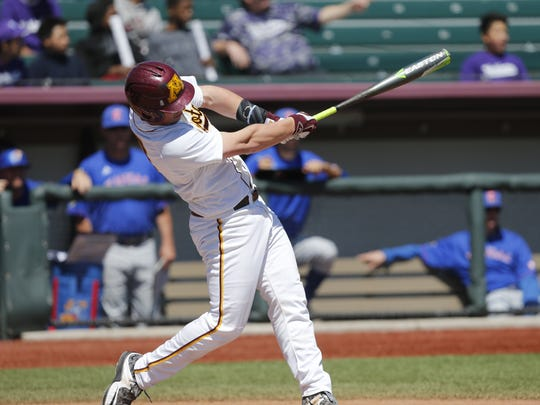 Rocori grad and Minnesota Gophers catcher Austin Athmann swings during a game this season.