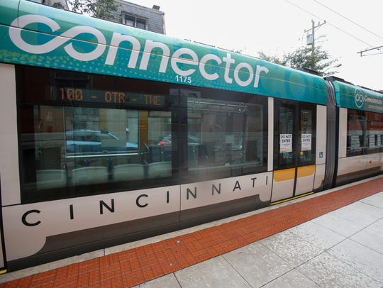 The Cincinnati Bell Connector Streetcar at a stop outside