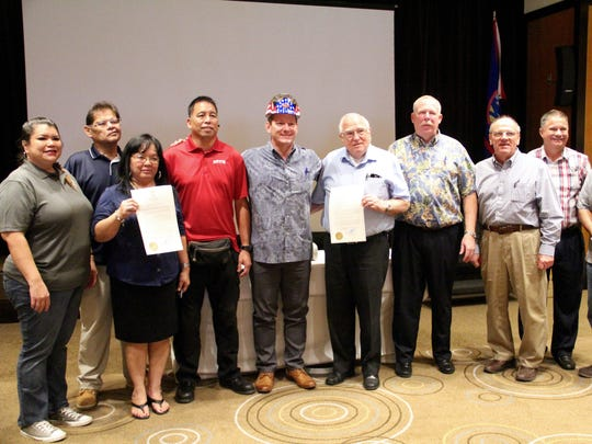 "Lt. Governor Ray Tenorio stands with board members of the Guam Contractors Association and Guam Trades Academy at the GCA's monthly meeting Oct. 19, where Tenorio signed a proclamation declaring October ""Careers in Construction Month."""