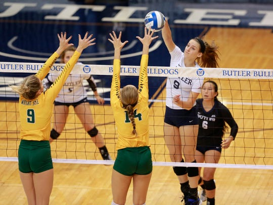 Butler's Anna Logan (9) gets high over the net against