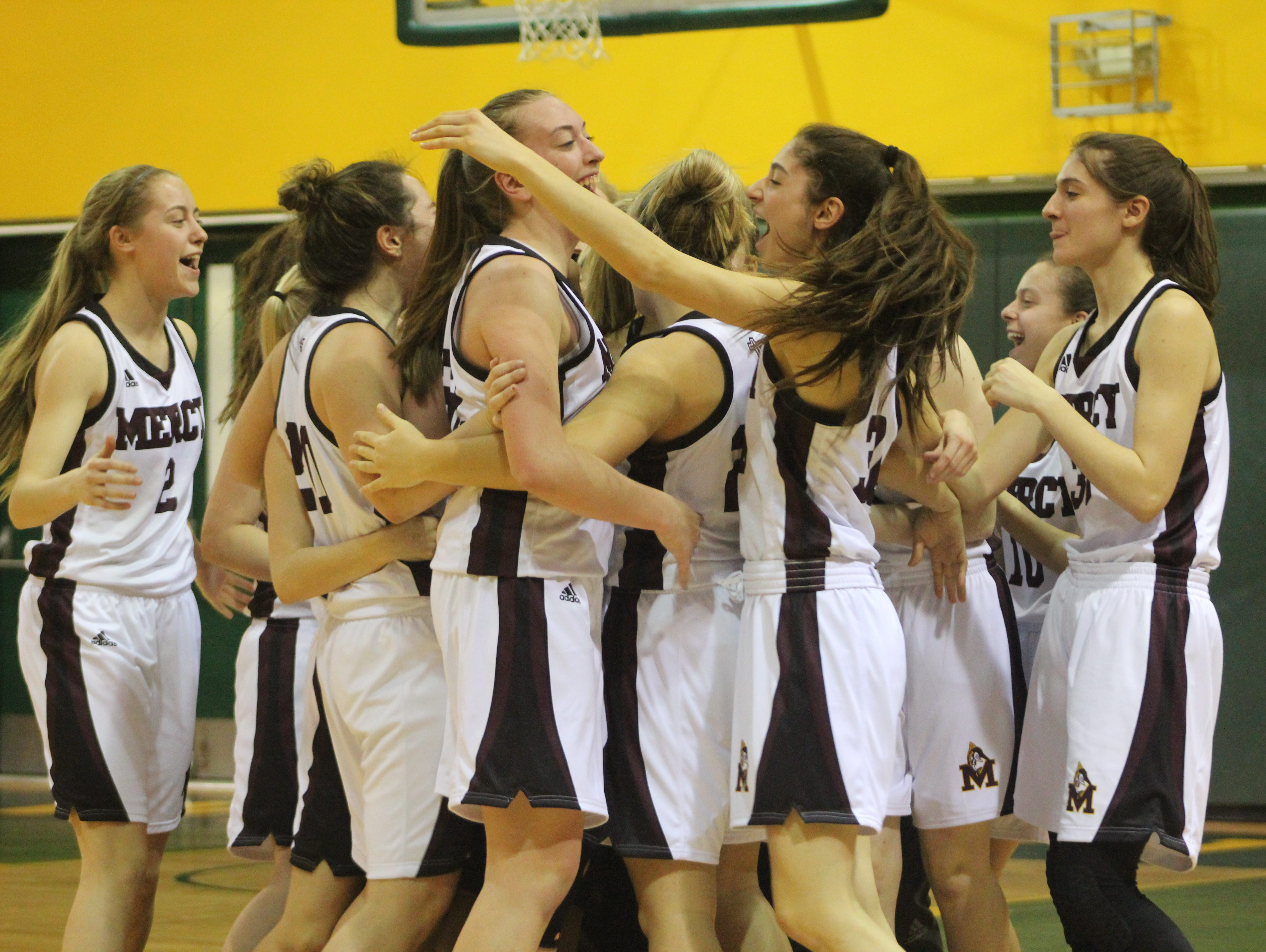 Farmington Hills Mercy players embrace after beating Birmingham Marian, 45-36, to win the Catholic League A/B Division girls basketball title Feb. 19 at Wayne State.