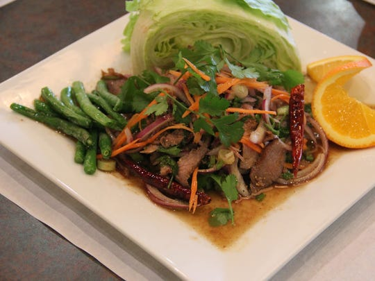Namtok Beef combines lime juice, aromatics, fish sauce and tender sliced beef for a powerfully flavorful entree.