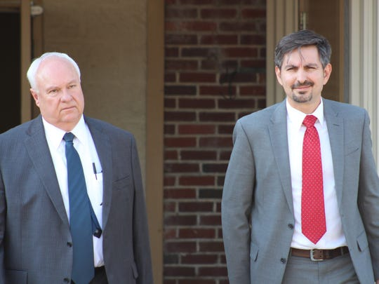 Louisiana assistant attorneys general John Sinquefield (left) and Matthew Derbes exit the Avoyelles Parish Courthouse Wednesday after resting their case against Derrick Stafford. The defense will begin its case Thursday morning as Stafford's trial on second-degree and attempted second-degree murder charges continues.