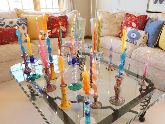 Barbara Kluth's living room coffee table is covered with colorful candles. She says she likes the ambience afforded by lit candles.
