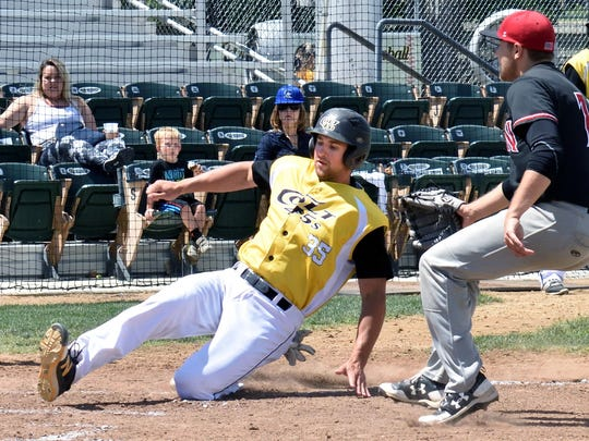 Shane Kotz of the Colt 45s scores on a wild pitch as part of a four-run rally in the third inning of Sunday's home game against the Auburn Wildcats. At right is Auburn pitcher Tristan Prybylinski. Redding won 9-3.