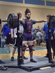 Powerlifting champion Zaven Ouzounian is a recent graduate of Racine Case who competed for Horlick.