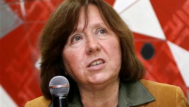 """In this photo taken on Tuesday, Sept. 16, 2014, Belarusian journalist Svetlana Alexievich speaks in Minsk, Belarus. Belarusian writer Svetlana Alexievich won the Nobel Prize in literature Thursday, Oct. 8, 2015, for works that the prize judges called """"a monument to suffering and courage."""" (AP Photo/Sergei Grits)"""