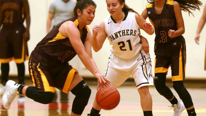 Andress' Daniela Vargas, left, steals the ball from Austin's Isabelle Duran during the second quarter Tuesday at Austin. Andress' Jordan Pinson is at right.