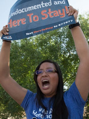 Yazmin Irazoqui, of Albuquerque, with the group p New Mexico Dream Team, gathered with members from chapters from Southern New Mexico and West Texas to protest along side NM Café in front of the border patrol station in Las Cruces, Thursday, May 4, 2017.