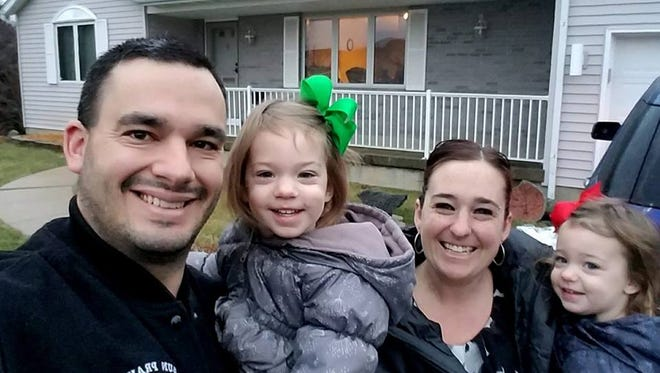Sun Prairie firefighter Cory Barr smiles with his family in his Facebook profile picture.