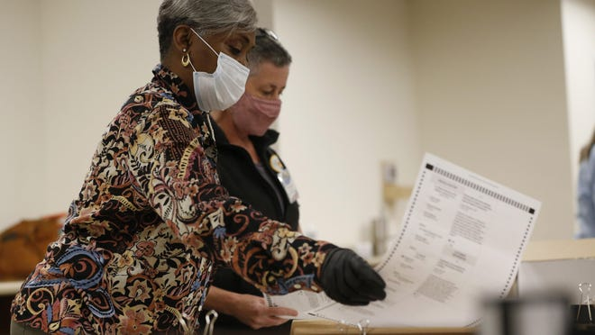 Athens-Clarke County poll workers hand recount ballots at Board of Elections Building in Athens, Ga., on Friday, Nov. 13, 2020.