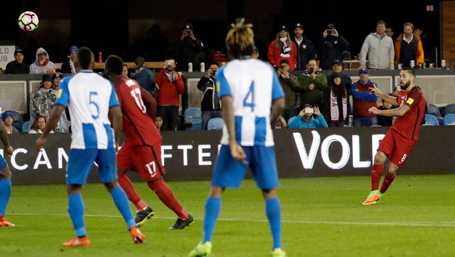 The United States' Clint Dempsey, right, scores on a free kick against Honduras during the second half of a World Cup qualifying soccer match Friday, March 24, 2017, in San Jose, Calif.