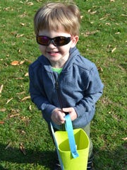 Oscar Hunter, 3, prepares for some serious egg hunting