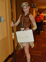 Janet Shaw dresses up as Rey from Star Wars.