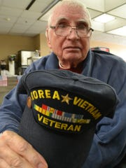 Randell Welborn of Anderson, shows off his veteran hat during lunch after the Richard M. Campbell Veterans' Nursing Home's Veterans Day service Friday.