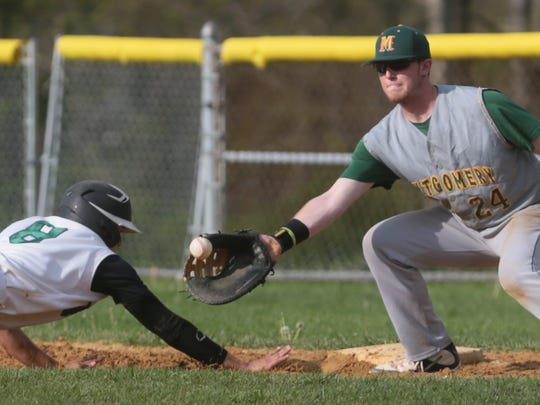 Ridge's Jack Albanese (8) dives back to first at Montgomery's Nick Marro (24) waits for the throw at Ridge baseball in Bernards on April 26, 2016. (Keith Muccilli/ Staff photographer)