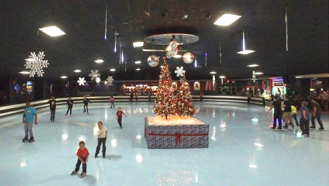 Roller skaters at Skateland West roll around Christmas trees inDecember 2016 at the rink in Westland. The $8 admission fee includes skate rental.