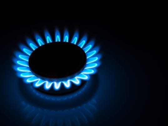 burning gas stove hob blue flames  in the dark