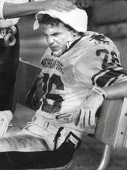 Blake Ezor has his head rubbed down during the fourth quarter of the Gator Bowl, Jan. 1, 1989