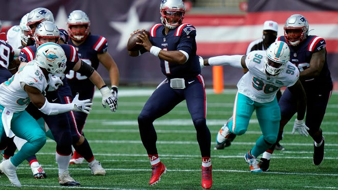 Patriots quarterback Cam Newton had Dolphins defenders guessing all day, this time throwing while under pressure on Sunday.