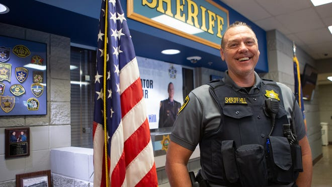 Sheriff Brian Hill smiles after accepting the Kansas State Lodge Fraternal Order of Police Administrator of the Year award Thursday at the Shawnee County Sheriff's Office.