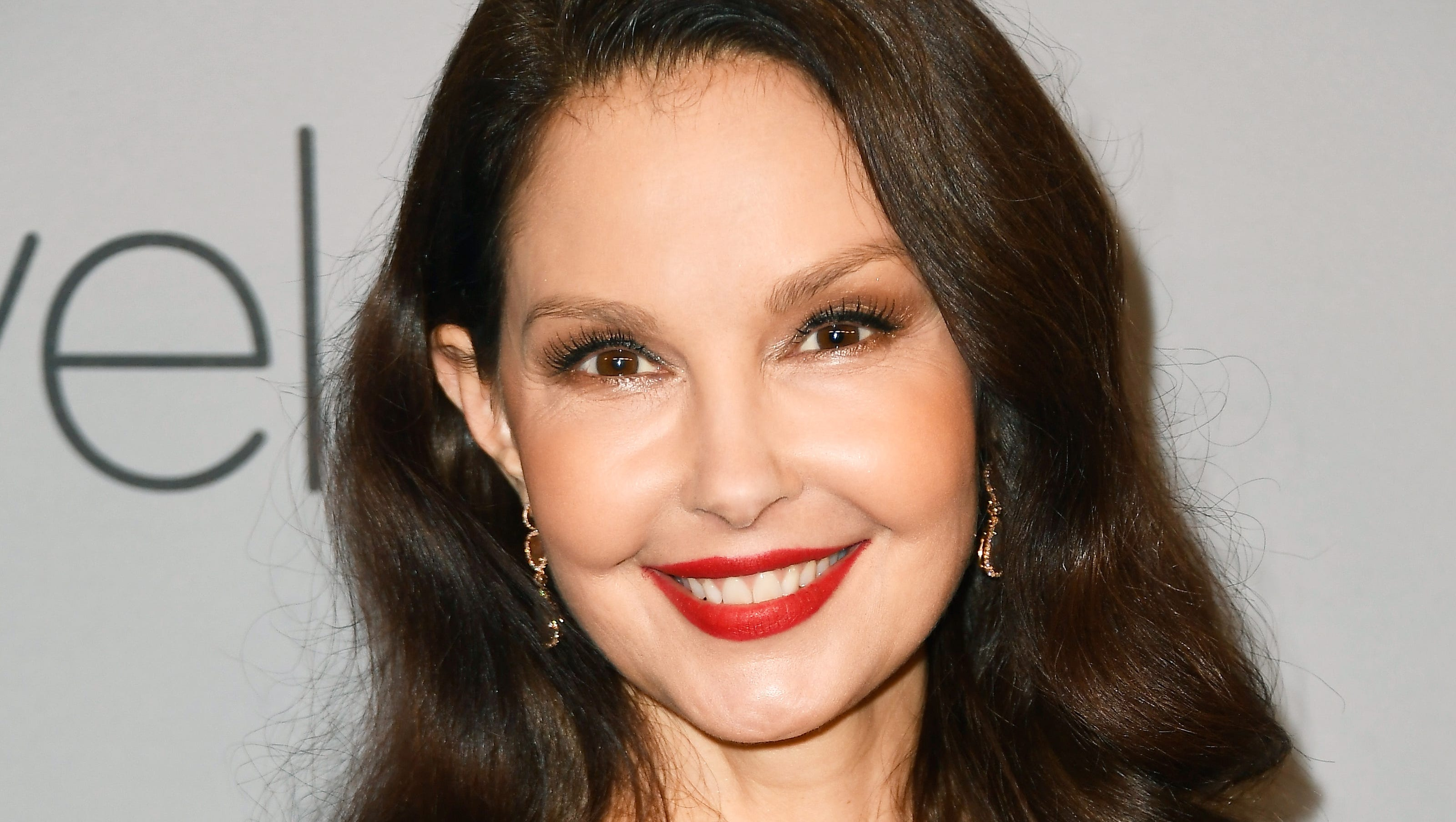 Ashley Judd takes first walk in Swiss mountains six months after shattering leg in four places