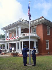 Members of the Sheppard Air Force Base Honor Guard salute the nation's flag Tuesday morning at the Kell House in Wichita Falls. Hundreds of people turned out for the 33rd annual celebration of the nation's birthday.