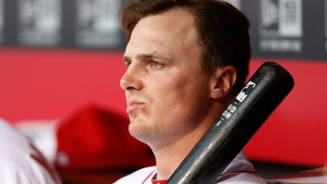 Reds right fielder Jay Bruce sits on the bench Friday against the Nationals.