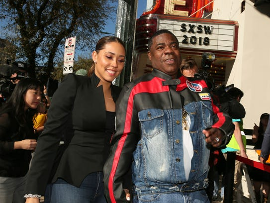 Tracy Morgan and his wife, Megan Wollover, arrive for