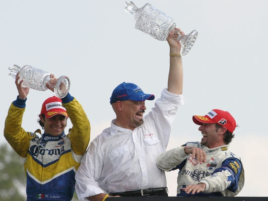 Rocketsports owner Paul Gentilozzi, center, celebrates his driver, Alex Tagliani's, right, victory in the Grand Prix of Road America Sunday, Aug. 8, 2004, in Elkhart Lake, Wis.  (AP Photo/David Boe)