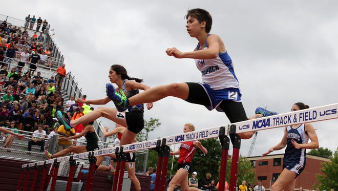 Alisa Blank of Waupaca clears a hurdle during Friday's WIAA state track meet at La Crosse. Blank was competing in the Division 2 300 hurdles.