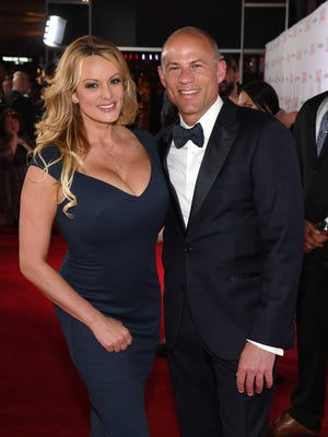 Adult film actress/director Stormy Daniels and attorney Michael Avenatti attend the 2019 Adult Video News Awards at The Joint inside the Hard Rock Hotel & Casino in Las Vegas, Nevada.