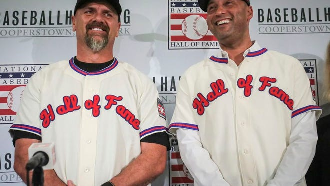 New York Yankees shortstop Derek Jeter, right, and Colorado Rockies outfielder Larry Walker pose after receiving their Baseball Hall of Fame Jerseys, Wednesday Jan. 22, 2020, during a news conference in New York.