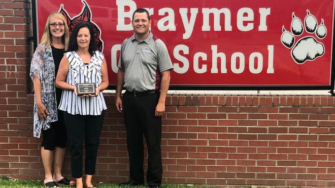 Jayme Caughron, GRTS Director; Becky O'Dell, Braymer C-4 Counselor; Adam Wolf, GRTS Assistant Director, pose outside Braymer C-4 School after presenting O'Dell the Grand River Technical School 2020 Outstanding Sending Schools' Educator Award.