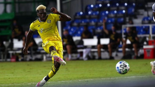 Crew forward Gyasi Zardes scores against FC Cincinnati during the MLS is Back tournament in Orlando in July.