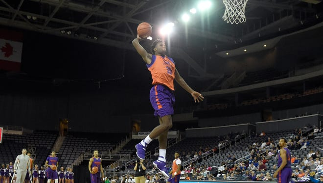 University of Evansville freshman John Hall attempts one last dunk during the slam dunk exhibition as the men's and women's basketball teams perform during Hoopfest at the Ford Center in Evansville Thursday.  The event also featured introductions to the teams, a 3-point shooting team challenge and team scrimmages.