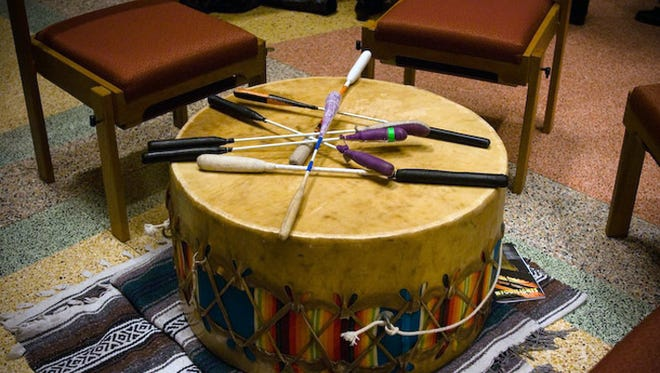 The Bucks Native American Singing and Drumming Group has performed at every Present Music Thanksgiving concert since 2000. Group members sit in a circle around a drum.