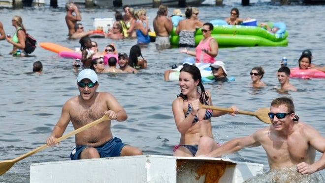 "<137>Racers complete in ""Anything That Floats"" on the Quietwater Sound behind the Portofino Boardwalk during the annual bathtub races on Pensacola Beach.<137><137><252><137>"