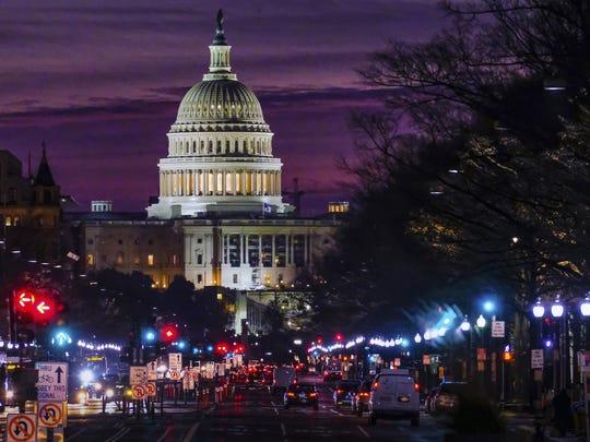 Early morning traffic rolls toward the U.S. Capitol