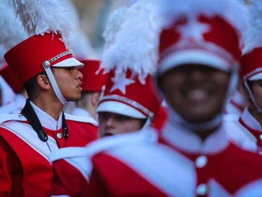 Naples High senior Luis Nicacio, 18, marches in the