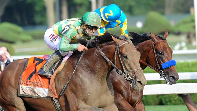 Keen Ice (7), with jockey Javier Castellano, moves past Triple Crown winner American Pharoah, with Victor Espinoza, to win the Travers Stakes horse race at Saratoga Race Course in Saratoga Springs, N.Y., Saturday, Aug. 29, 2015.