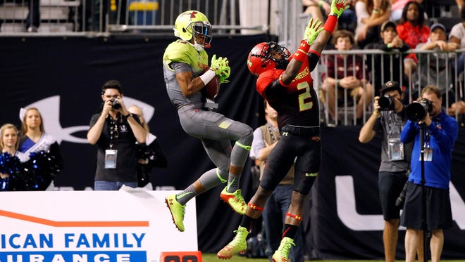 Team Nitro wide receiver Malachi Dupre (left) makes a catch over Team Highlight cornerback Jermaine Roberts during the Under Armour All-America game in January. Dupre, a John Curtis High graduate, is expected to be one of the top receivers for LSU this season.