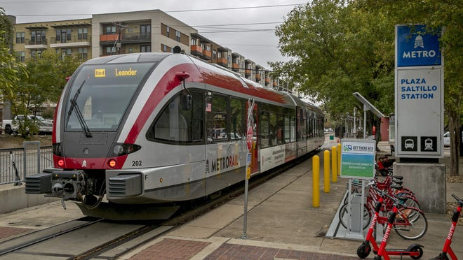 A Capital Metro MetroRail commuter train departs from the Plaza Saltillo Station in Austin.