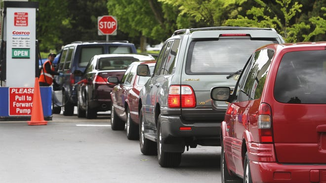 Motorists wait in line for gas at Costco in Salem. Wednesday, May 23, 2012.