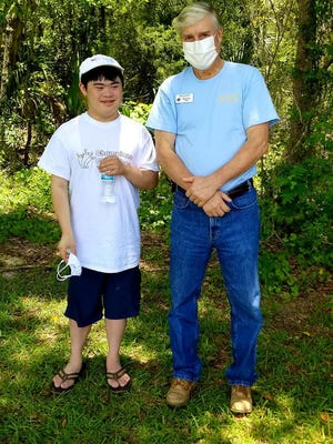David Ethier, right, of Knights of Columbus Sacred Heart #8012, enjoys a visit with  Champions participant Jasper.
