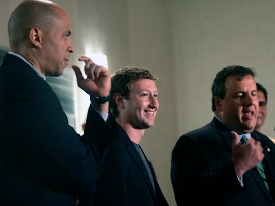 Newark Mayor Cory Booker, left, and Mark Zuckerberg,