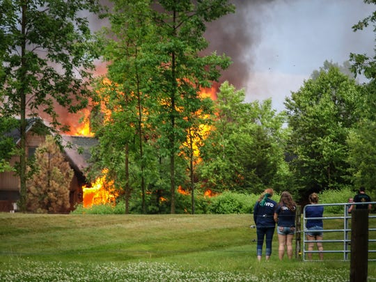 As more fire crews responded, flames engulfed the home