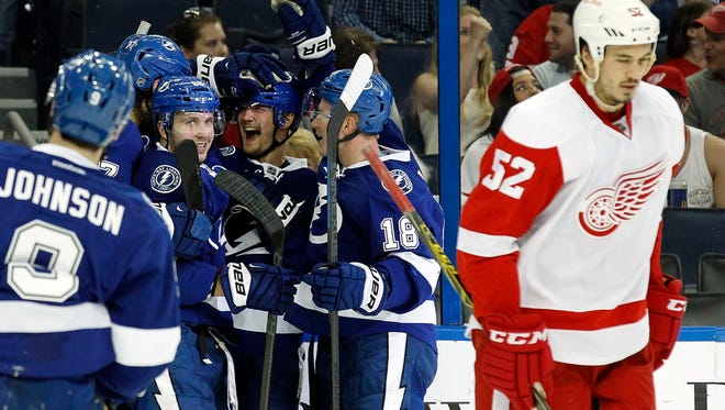 Tampa Bay Lightning defenseman Anton Stralman (6) is congratulated by teammates after he scored against the Detroit Red Wings during the second period at Amalie Arena.